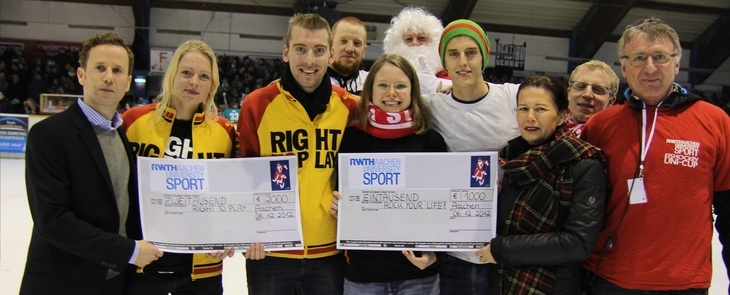 Group of people holding oversized cheques